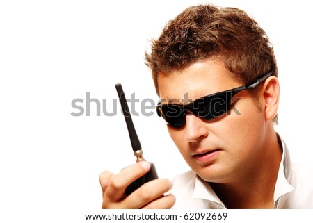 Young security man with radio transmitter over white background