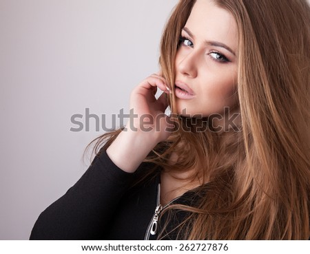 Young sensual & beauty model girl pose in studio.