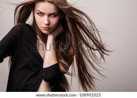 Young sensual model girl pose in studio.