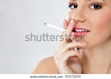 Young sensual woman smoking