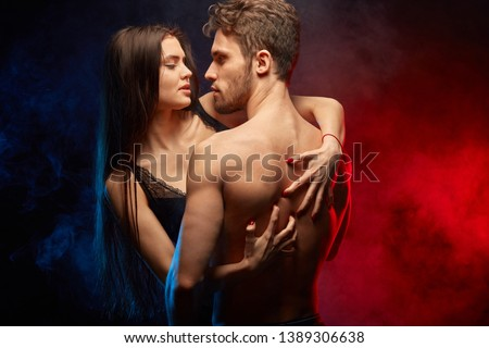 young sensual woman thrusting sharp nails on the man's back. close up photo #1389306638