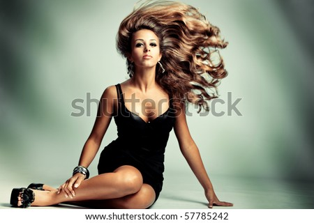 young sensual woman with long flying hair, studio shot