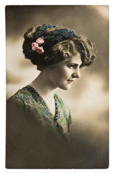 young sentimental woman with flowers. vintage picture ca. 1913