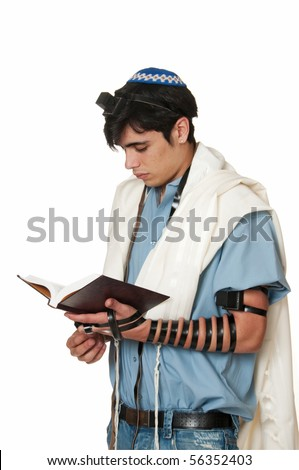 Young Sephardic Jewish Man In Tallit And Tefillin Does Morning Prayers ...