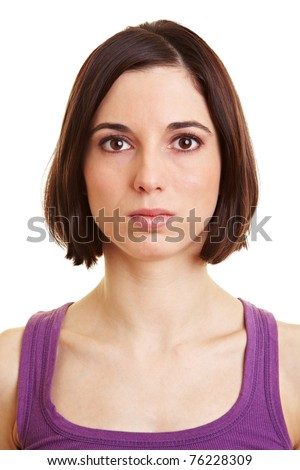 Young serious attractive woman looking into the camera