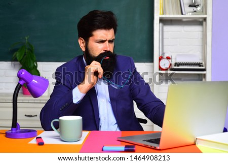 Young serious bearded teacher. Student preparing for test or exam. Back to school. Male student in university. Confident male teacher in auditorium. Education, knowledge concept. Educational process. #1464908213
