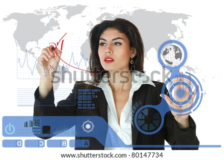 Young serious businesswoman working on modern touch screen