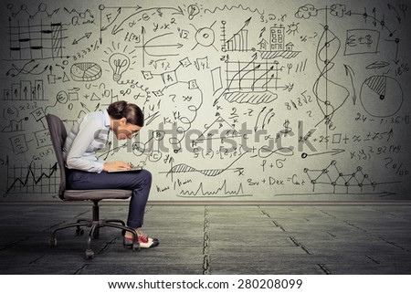 Young serious woman working on computer sitting on chair  #280208099