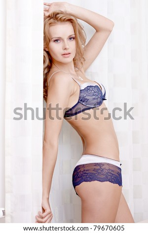 young sexy blond woman in sexy lingerie