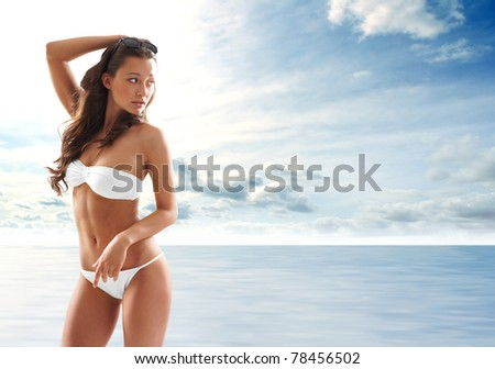 Young sexy brunette in swimsuit