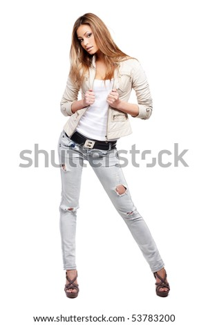 Young sexy brunette woman in white shirt and blue jeans isolated on white