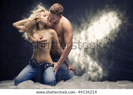 stock photo Young sexy couple in a studio Toned