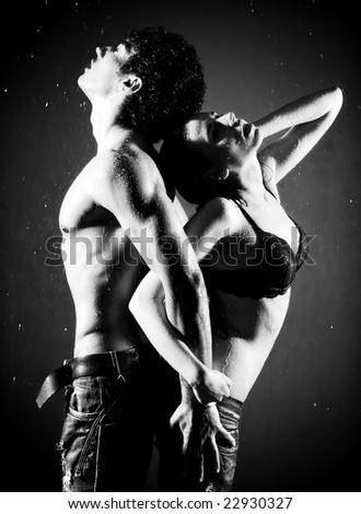 Young sexy couple. Water studio photo. Black and white.