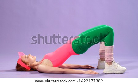 young sexy female aerobics instructor doing aerobic exercises.