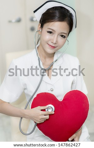 young sexy female Asian nurse in white uniform