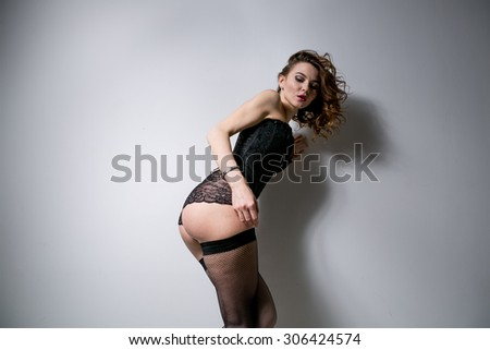 young sexy girl in erotic lingerie studio #306424574
