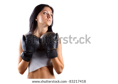 Young sexy girl over white background with boxing gloves
