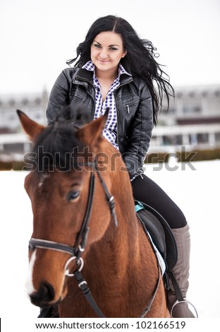 Young sexy girl riding horse