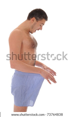 Young sexy handsome man looking in his pants - stock photo