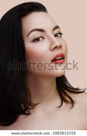 Young sexy lady with clean skin red lips and black straight hairstyle. Mixed race Caucasian Asian female model isolated on beige background #1083812318