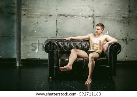 Sexy naked man on couch