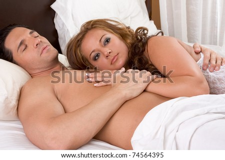 Young sexy naked heterosexual couple love in bed