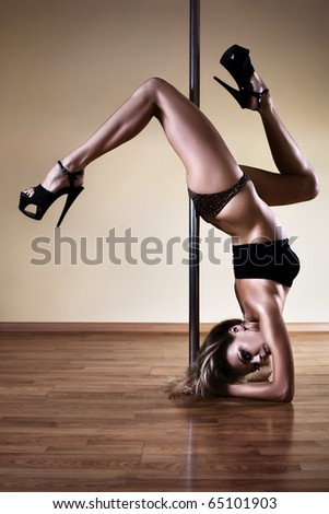 Young sexy pole dance woman. Contrast colors.