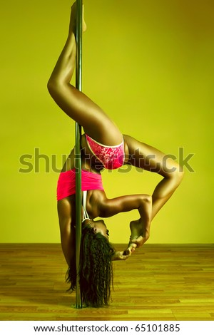 Young sexy pole dance woman. Vibrant yellow and green colors.