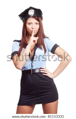young sexy policewoman, telling us to be silent, isolated against white background