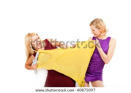 Young sexy shopping woman fighting for a dress. isolated on white background