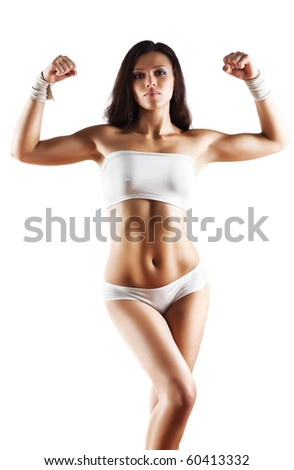 Young sexy sporty woman. Isolated on white.