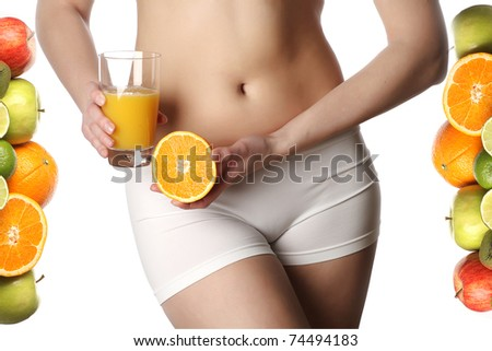 Young sexy woman body with orange juice isolated on white