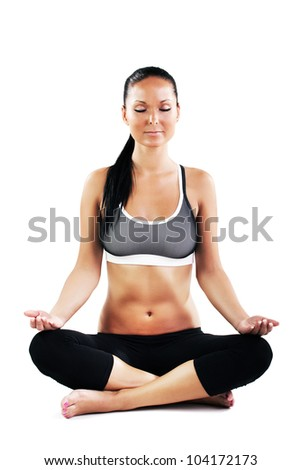 Young sexy woman doing yoga exercise - meditating