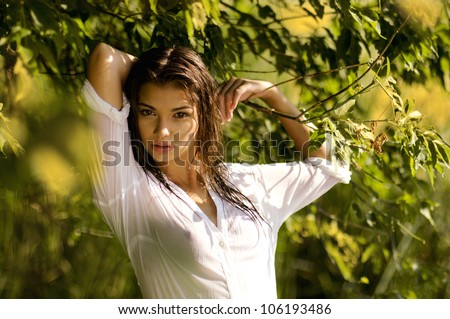 young sexy woman  in a wet shirt,series of portrait outdoors