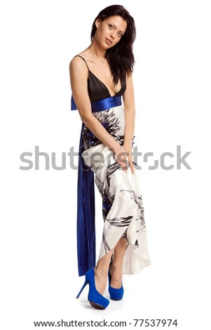 Young sexy woman in evening dress over white background