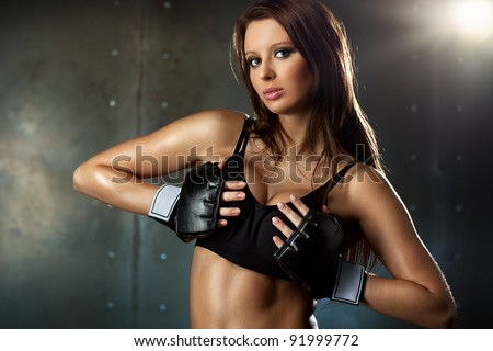 Young sexy woman in fighting gloves.