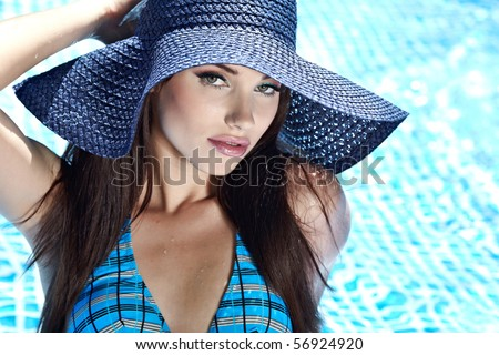 Young sexy woman in the pool