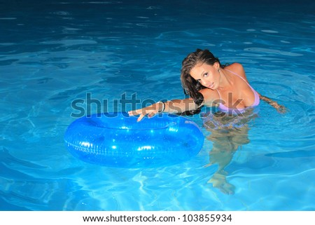 Young sexy woman in the swimming pool at night stock photo 103855934 shutterstock for Female only swimming pool london