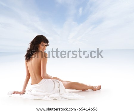 Young sexy woman meditating over sea background