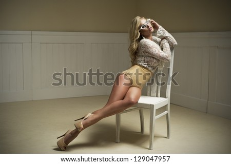 Young sexy woman on chair.