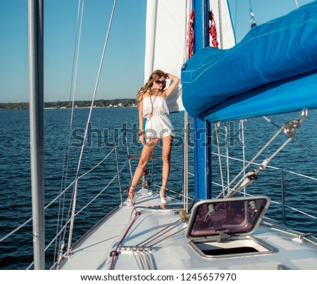 Young sexy woman on her private yacht #1245657970