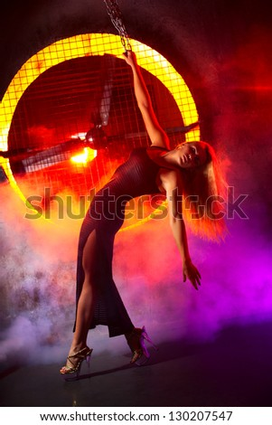 Young sexy woman on industrial background.