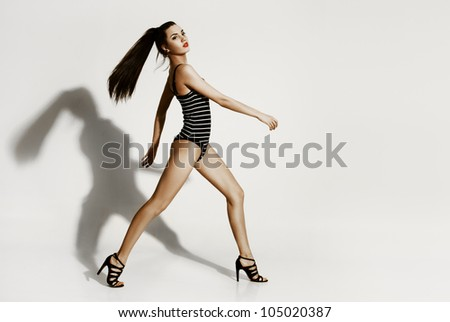 Young sexy woman on the white background