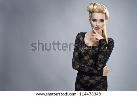 Young sexy woman on wall background portrait.