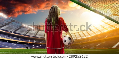 Young sexy woman player in soccer stadium