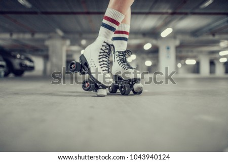 young sexy woman rollerskating...