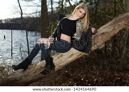 Young Sexy Woman Sitting On Branch Of Old Tree. #1424564690