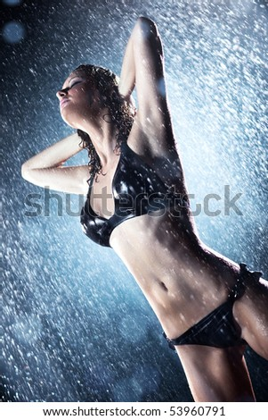 Young sexy woman. Water studio photo.