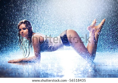 Young sexy woman. Water studio photo. - stock photo