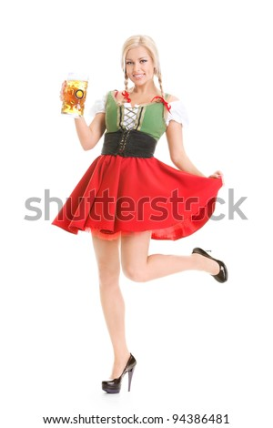 young sexy woman wearing a dirndl with beer mug over white